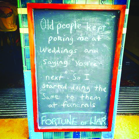 Sydney's oldest pub Fortune of War greets visitors with this funny chalkboard message