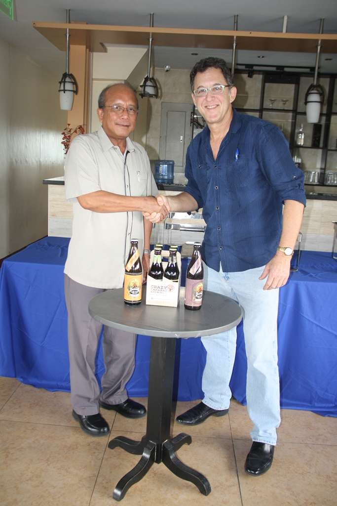 Department of Tourism Region 3 head Ronnie Tiotuico, seen here with TLC Promotions Ted Lerner, endorses the Angeles City Craft Beer Festival